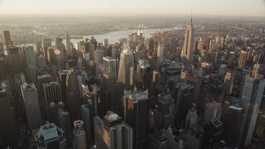 4K stock footage aerial video Flying by Midtown Manhattan, Empire State Building, New York, sunrise Aerial Stock Footage | AX90_047