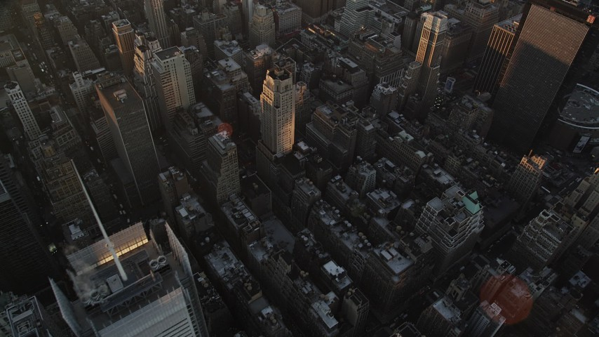 4K aerial video Flying over Midtown Manhattan, reveal Empire State Building, New York, sunrise Aerial Stock Footage | AX90_048
