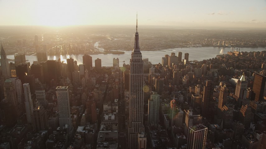 5k aerial video Flying by Empire State Building, Midtown Manhattan, New York, sunrise Aerial Stock Footage AX90_050