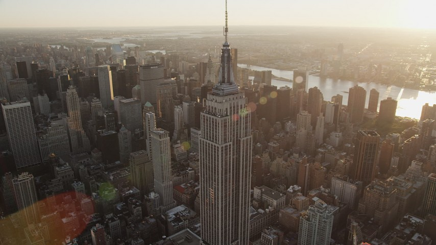 5k aerial video Flying by the Empire State Building, Midtown Manhattan, New York, sunrise Aerial Stock Footage | AX90_051