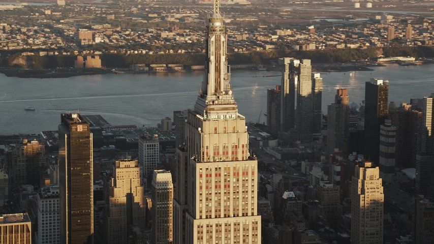 5k aerial video Flying by Empire State Building, Midtown Manhattan, New York, sunrise Aerial Stock Footage | AX90_054