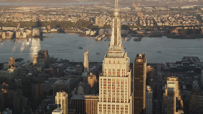 4K stock footage aerial video Flying by Empire State Building, Midtown Manhattan, New York, sunrise Aerial Stock Footage | AX90_055