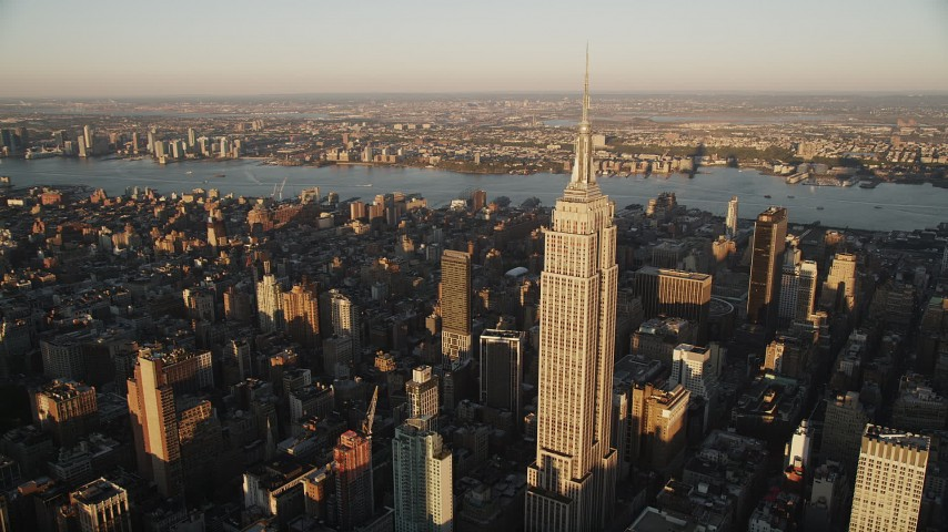 4K stock footage aerial video Flying by Empire State Building, Midtown Manhattan, New York, sunrise Aerial Stock Footage | AX90_056