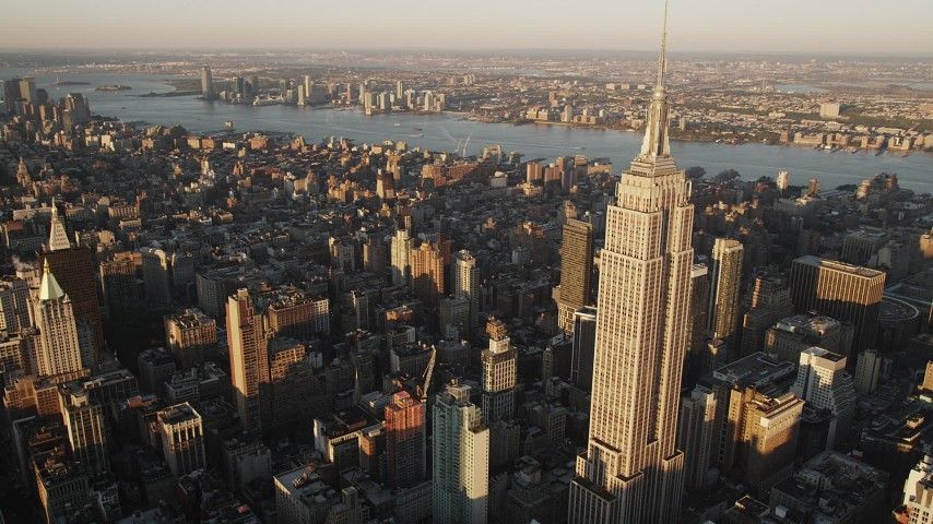 Flying by Empire State Building, Midtown Manhattan, New York, sunrise Aerial Stock Footage | AX90_057
