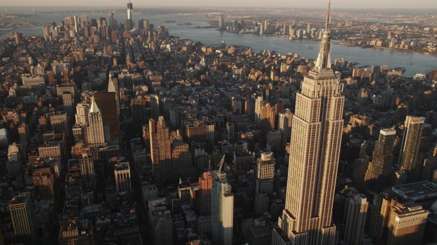 4K stock footage aerial video Flying by Empire State Building, Midtown Manhattan, New York, sunrise Aerial Stock Footage | AX90_058