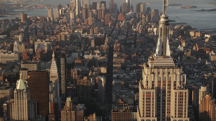 4K stock footage aerial video Flying by Empire State Building, Midtown Manhattan, New York, sunrise Aerial Stock Footage | AX90_059