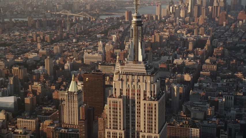 4K stock footage aerial video Flying by Empire State Building, Midtown Manhattan, New York, sunrise Aerial Stock Footage AX90_060 | Axiom Images