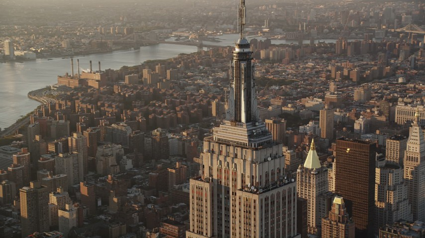 Flying by Empire State Building, Midtown Manhattan, New York, sunrise Aerial Stock Footage | AX90_061