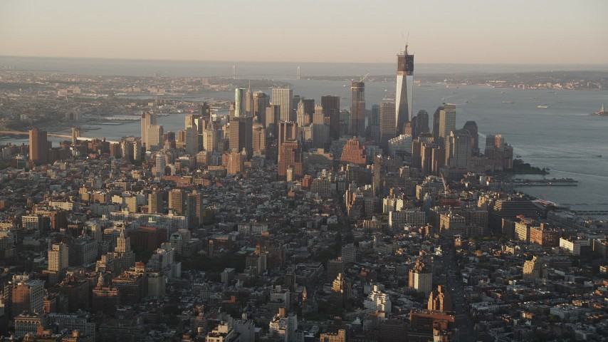 4K stock footage aerial video Flying by Lower Manhattan, seen from Midtown, New York, New York, sunrise Aerial Stock Footage | AX90_062