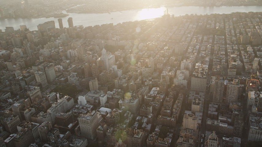 4K stock footage aerial video Panning across East Village, revealing Midtown Manhattan, New York, sunrise Aerial Stock Footage | AX90_066