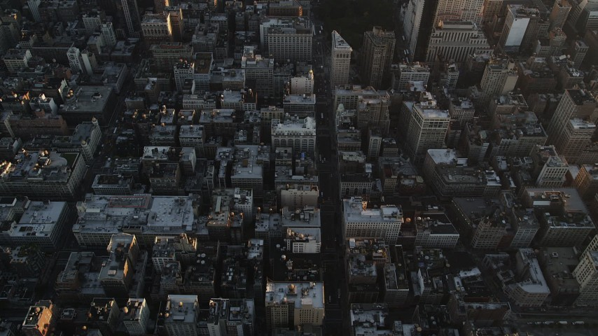 4K stock footage aerial video of 5th Avenue, reveal Empire State Building, Midtown Manhattan, New York, sunrise Aerial Stock Footage | AX90_067