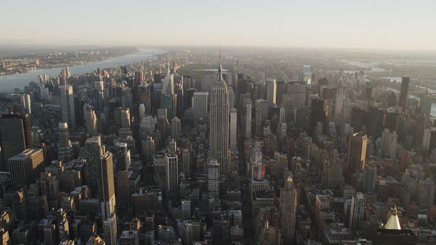 4K stock footage aerial video Approaching Empire State Building, Midtown Manhattan, New York, sunrise Aerial Stock Footage | AX90_068