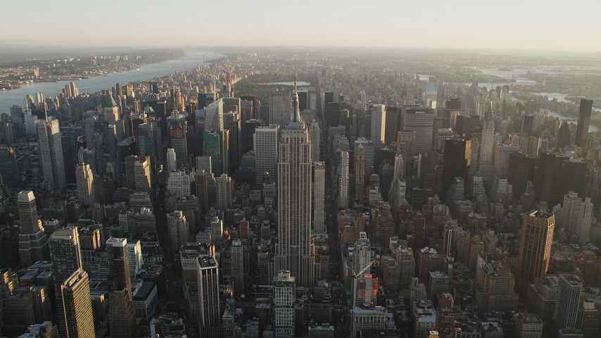 4K stock footage aerial video Approaching Empire State Building, Midtown Manhattan, New York, sunrise Aerial Stock Footage | AX90_069