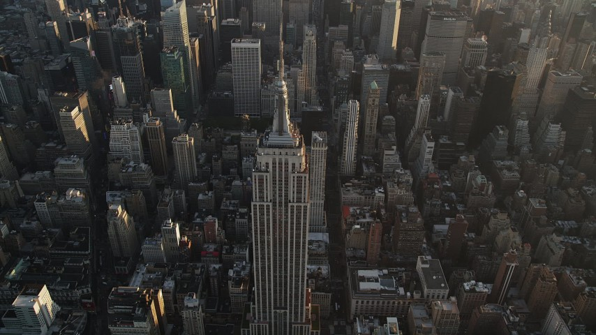 4K aerial video Approaching Empire State Building, Midtown Manhattan, New York, sunrise Aerial Stock Footage | AX90_071