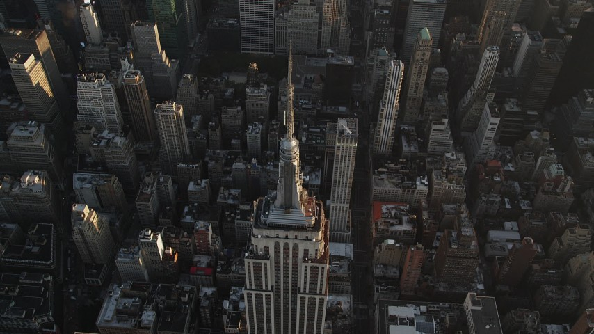 4K stock footage aerial video of a Bird's eye view over Empire State Building, New York, New York, sunrise Aerial Stock Footage | AX90_072