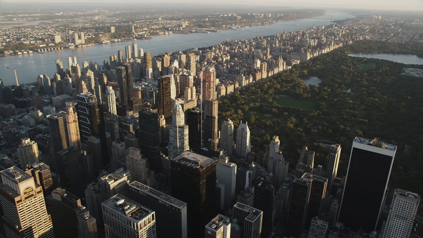 Flying by Midtown Manhattan skyscraper, New York, New York, sunrise Aerial Stock Footage | AX90_076