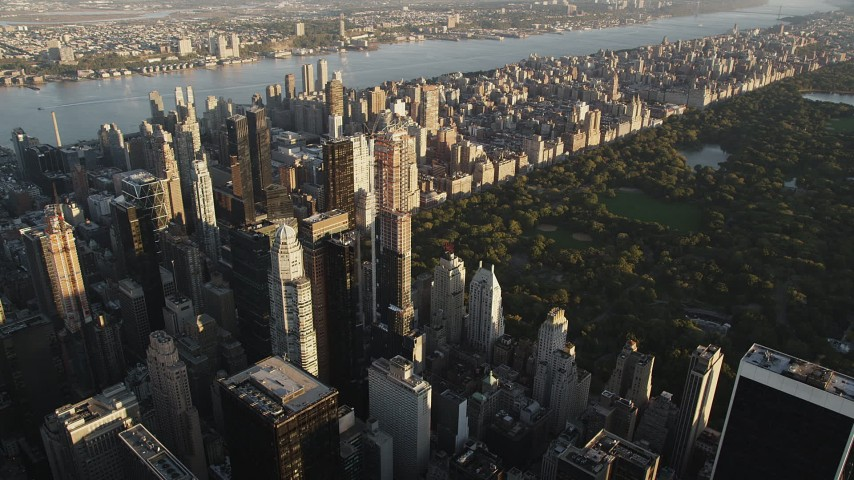 4K stock footage aerial video Flying by Midtown Manhattan skyscraper, New York, New York, sunrise Aerial Stock Footage | AX90_077