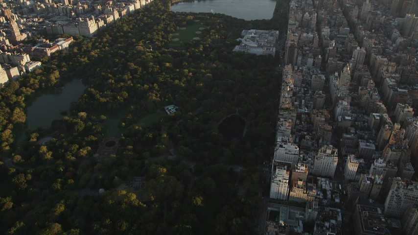 4K aerial video Flying over Central Park, Metropolitan Museum of Art, New York, sunrise Aerial Stock Footage | AX90_080