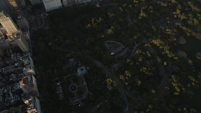 4K stock footage aerial video Flying over Central Park, revealing Midtown Manhattan, New York, sunrise Aerial Stock Footage | AX90_081