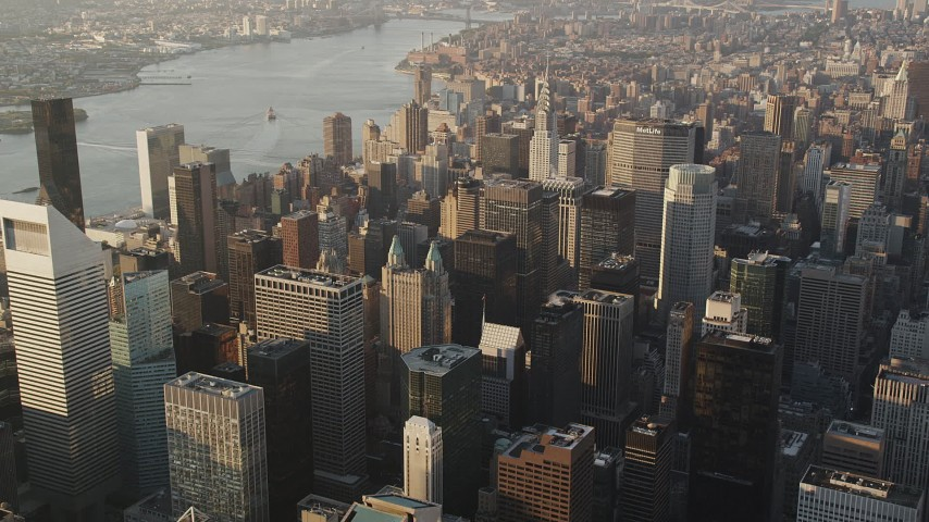 4K stock footage aerial video Panning left by Midtown Manhattan skyscrapers, New York, New York, sunrise Aerial Stock Footage | AX90_082