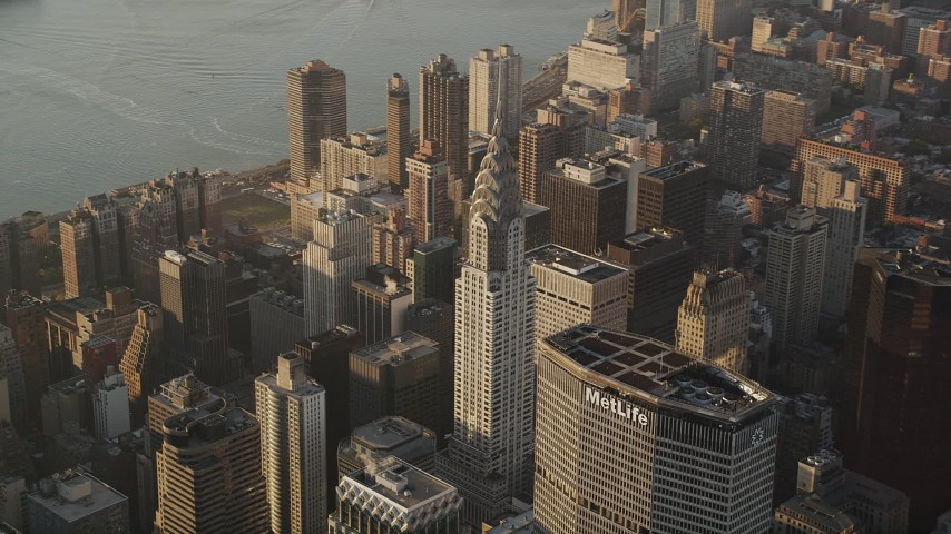 4K stock footage aerial video Flying by Chrysler Building, Midtown Manhattan, New York, New York, sunrise Aerial Stock Footage | AX90_085