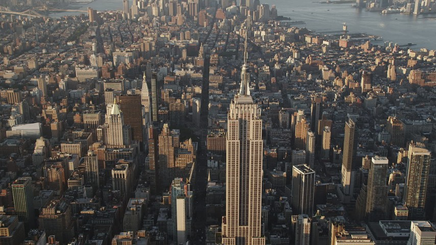 4K stock footage aerial video Approaching Empire State Building, Midtown Manhattan, New York, sunrise Aerial Stock Footage | AX90_086