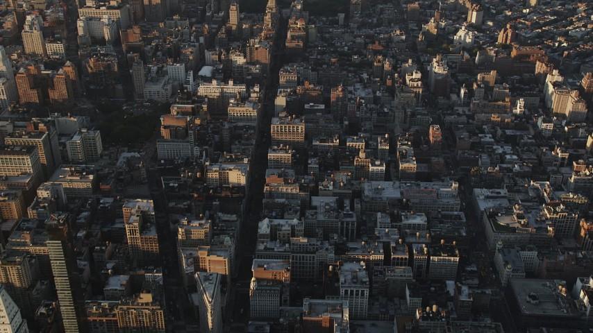 4K stock footage aerial video Flying over Chelsea, revealing Lower Manhattan, New York, New York, sunrise Aerial Stock Footage | AX90_089