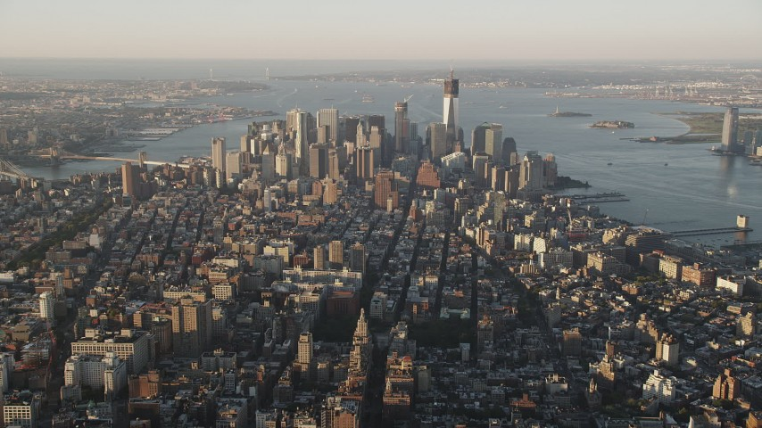 5k aerial video Approaching Lower Manhattan, seen from Chelsea, New York, New York, sunrise Aerial Stock Footage | AX90_090