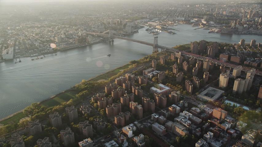 4K stock footage aerial video Approaching Williamsburg Bridge, Lower East Side, New York, sunrise Aerial Stock Footage | AX90_092