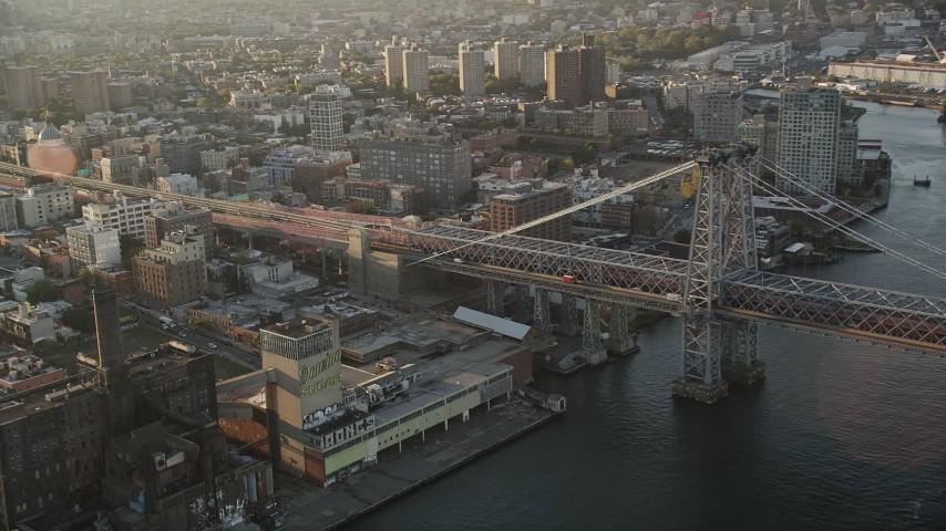 4K stock footage aerial video Flying by Williamsburg Bridge, East River, New York, New York, sunrise Aerial Stock Footage | AX90_096