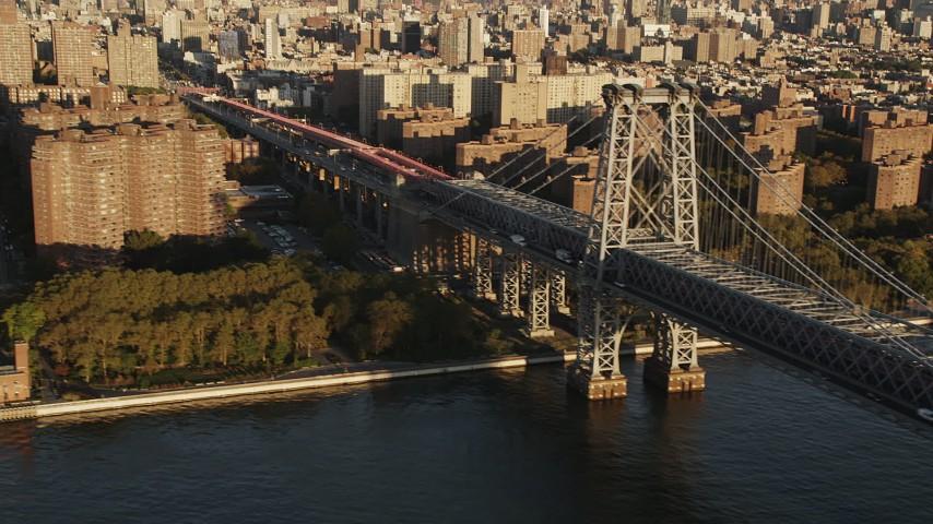 4K stock footage aerial video Tracking light traffic over the Williamsburg Bridge, New York, New York, sunrise Aerial Stock Footage AX90_097 | Axiom Images
