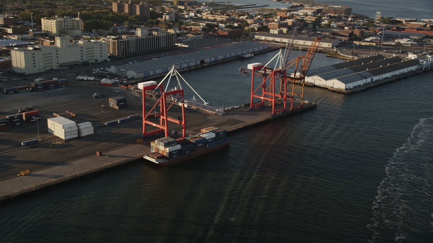 4K stock footage aerial video Approaching cargo cranes, Brooklyn Cruise Terminal, Brooklyn, New York, sunrise Aerial Stock Footage | AX90_109