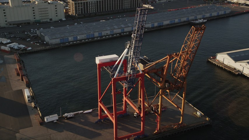 4K stock footage aerial video Flying by cargo cranes, Brooklyn Cruise Terminal, Brooklyn, New York, sunrise Aerial Stock Footage | AX90_110