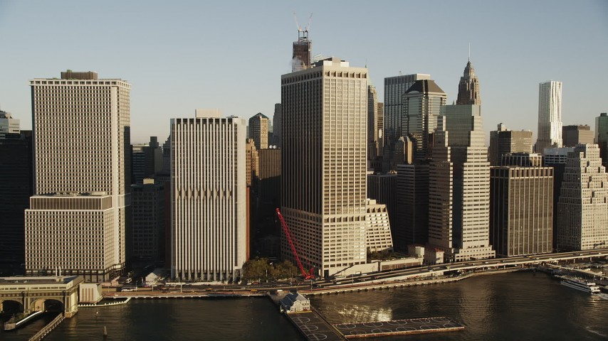4K aerial video Approaching Lower Manhattan skyscrapers, New York, New York, sunrise Aerial Stock Footage | AX90_114