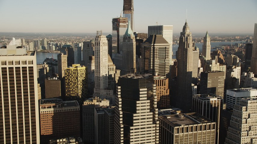 5k aerial video Approaching Lower Manhattan skyscrapers, New York, New York, sunrise Aerial Stock Footage | AX90_115