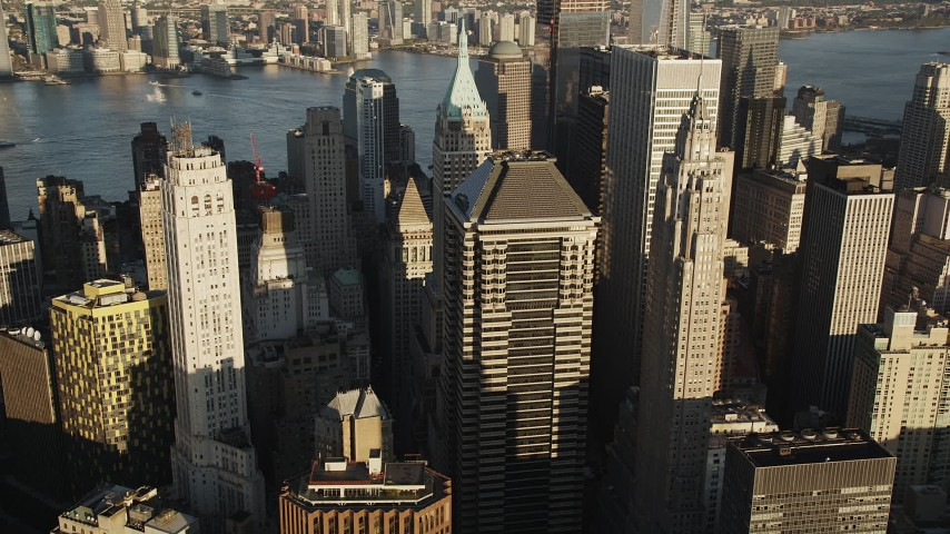 4K stock footage aerial video Flying by Lower Manhattan skyscrapers, New York, New York, sunrise Aerial Stock Footage | AX90_116