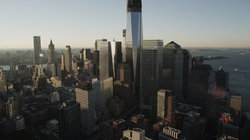 4K aerial video Flying by World Trade Center, Lower Manhattan, New York, New York, sunrise Aerial Stock Footage | AX90_122