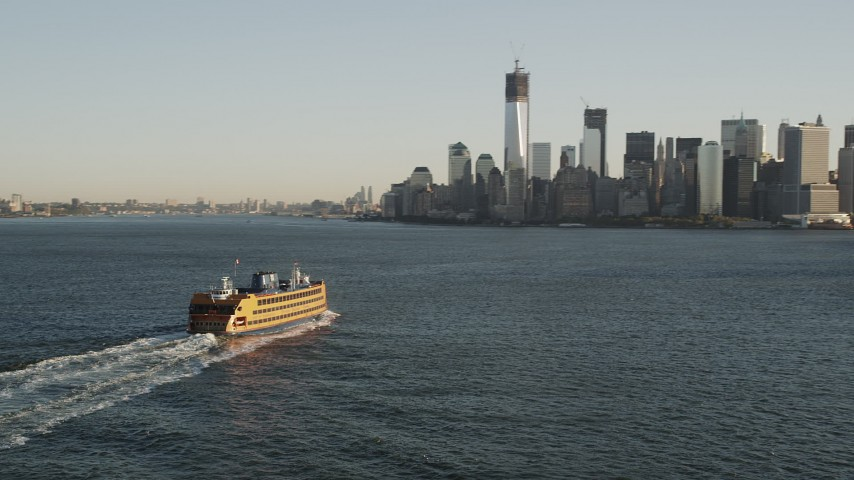 4K aerial video Flying by Staten Island Ferry, approaching Lower Manhattan, New York, sunrise Aerial Stock Footage | AX90_129