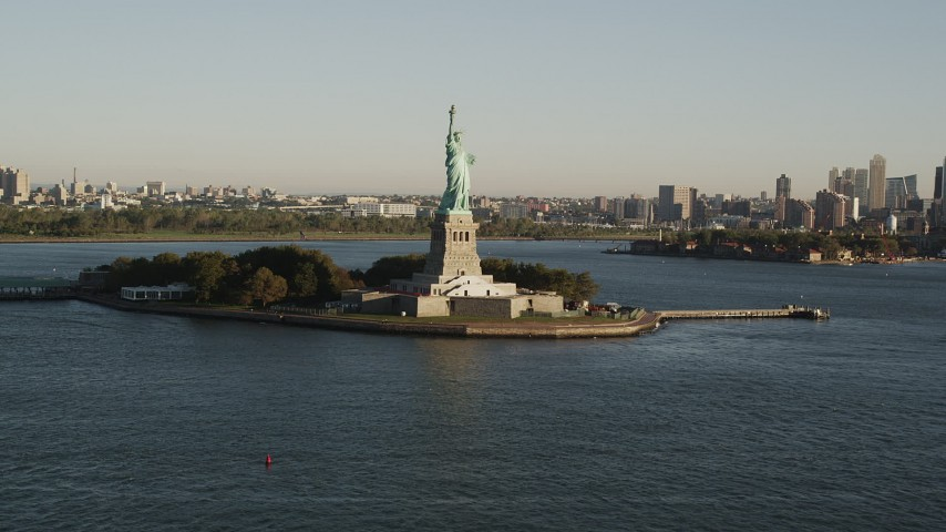 4K aerial video Approaching Statue of Liberty, Liberty Island, New York, New York, sunrise Aerial Stock Footage | AX90_149