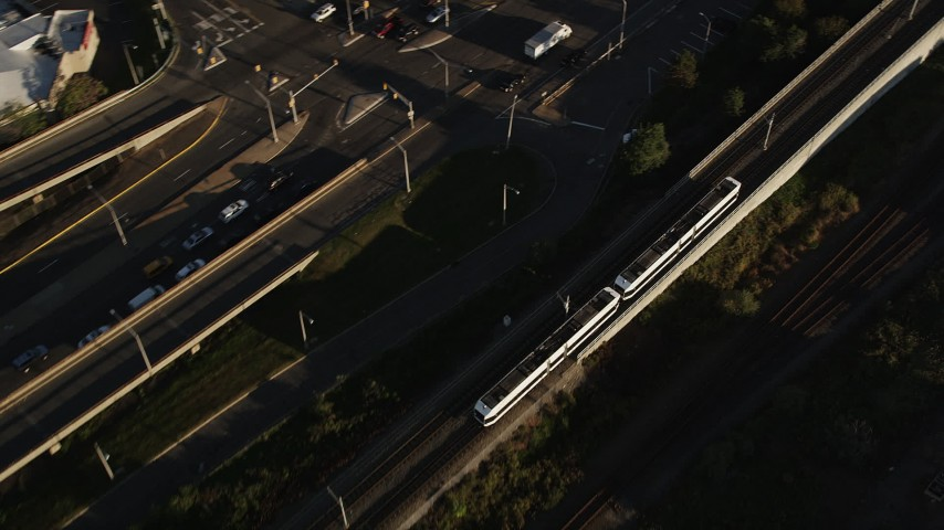 4K stock footage aerial video Tracking a commuter train, Jersey City, New Jersey, sunrise Aerial Stock Footage | AX90_160