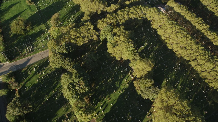4K stock footage aerial video Flying by Bayview New York Bay Cemetery, Jersey City, New Jersey, sunrise Aerial Stock Footage | AX90_164