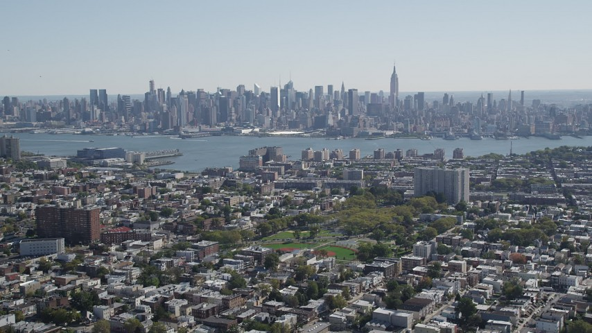 4K stock footage aerial video of the Midtown Manhattan skyline and Hudson River, New York, seen from Union City, New Jersey Aerial Stock Footage | AX91_001