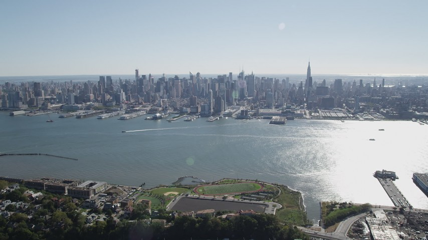 4K aerial video of the Midtown Manhattan skyline and Hudson River in New York seen from Union City, New Jersey Aerial Stock Footage | AX91_004