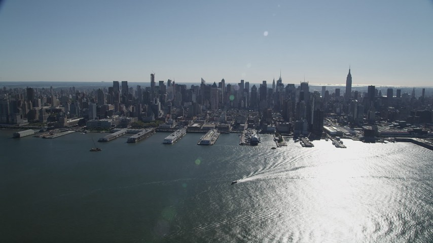 4K stock footage aerial video of passing by Midtown Manhattan skyline, seen from Hudson River, New York, New York Aerial Stock Footage | AX91_006
