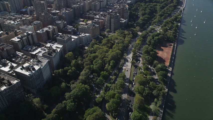 4K stock footage aerial video of flying away from Henry Hudson Parkway, Upper West Side, New York, New York Aerial Stock Footage | AX91_012