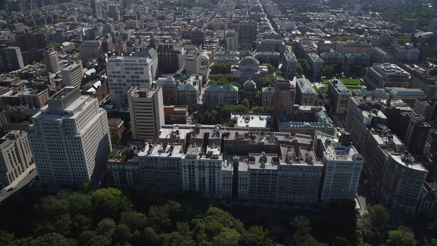 4K stock footage aerial video of passing by apartment buildings and Columbia University, Morningside Heights, New York Aerial Stock Footage | AX91_014