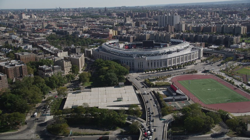 4K stock footage aerial video tilt from Macombs Dam Bridge, reveal Yankee Stadium, The Bronx, New York Aerial Stock Footage | AX91_018