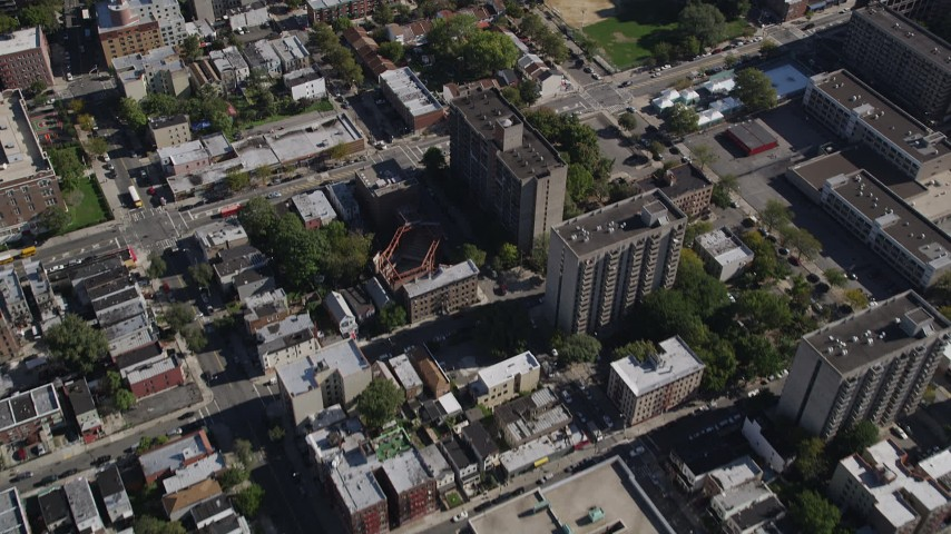 4K stock footage aerial video of a bird's eye view of apartment buildings and row houses in The Bronx, New York, New York Aerial Stock Footage | AX91_022
