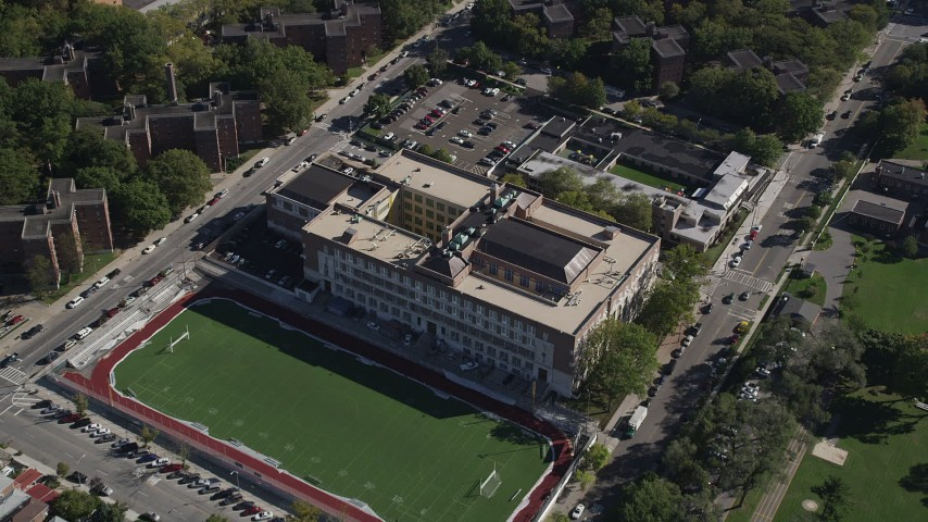 4K stock footage aerial video approach Christopher Columbus High School and tilt to a bird's eye view of the building, The Bronx, New York Aerial Stock Footage | AX91_024