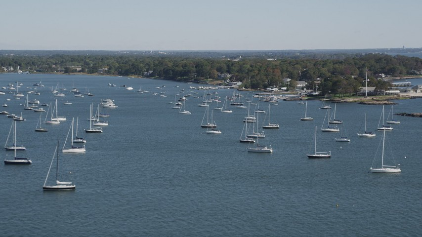 4K stock footage aerial video of flying by sailboats near the coast, Rye, New York Aerial Stock Footage | AX91_041